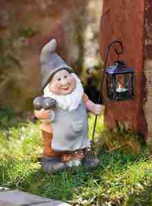 large garden gnome with latern